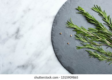 Fresh green rosemary and peppers mix on slate blackboard. Concept cooking. Top view, copy space.