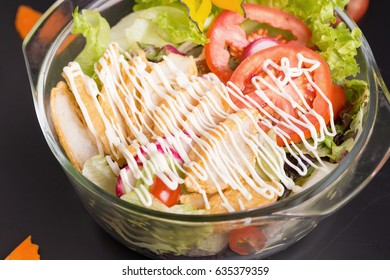 Fresh green salad with chicken and lettuce Fresh summer background Healthy eating.