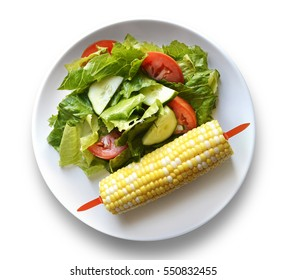 Fresh green salad with corn on the cob
