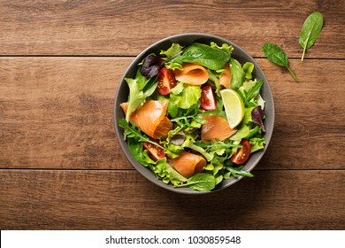 Fresh green salad with smoked salmon and cherry tomatoes