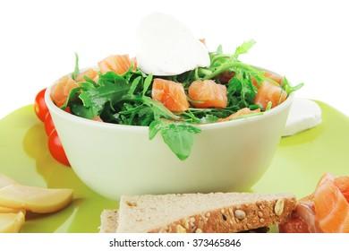 fresh green salad with smoked salmon on plate