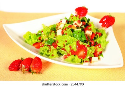 Fresh green salad with strawberry dressing