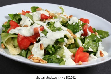 fresh green salad with tomatoes and cucumbers