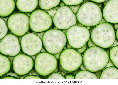 Fresh green slices of cucumber as background