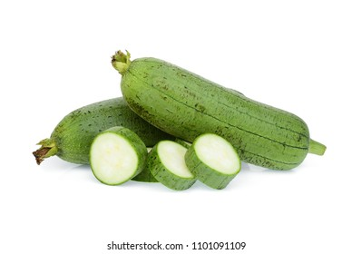 fresh green sponge gourd or luffa with slice isolated on white background