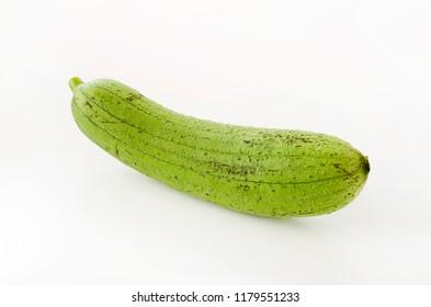 fresh green sponge gourd or luffa isolated on white background