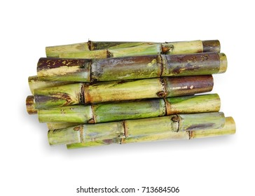 Fresh green sugar cane cut into slices before it is squeezed into sugar isolated on white background.This has clipping path.