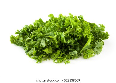 Fresh green superfood kale leaves isolated on white background