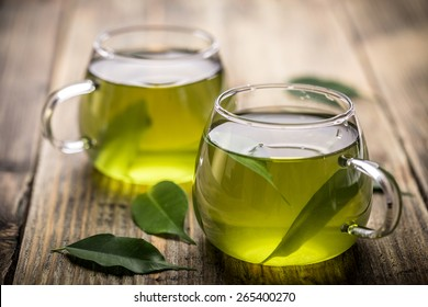 Fresh green tea with tea leaves in the water