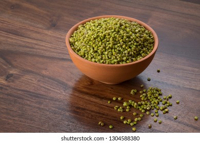 Fresh Green Tender Sorghum in a Earthen Bowl on Wooden Background