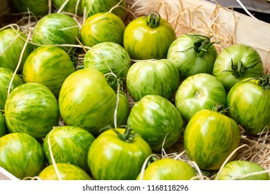 Fresh Green Tomatoes in a Crate on Sale in Borough Market, Southwark, London UK