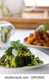 Fresh green vegetable salad with corn and basil