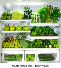 Fresh green vegetables and fruits in fridge.