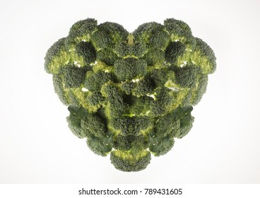 fresh green vegetables in heart shape placed on white background