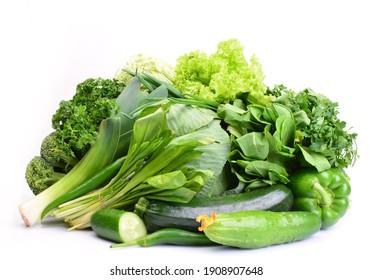 Fresh green vegetables on white background