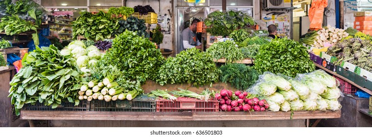 Fresh green vegetables and roots in Carmel market Tel Aviv
