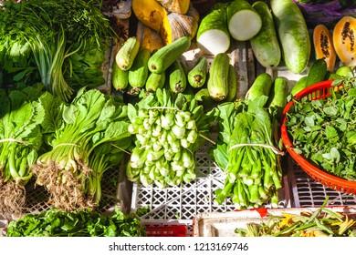 Fresh green vegetables for sell on the Vietnamese street market. Nha Trang, Vietnam.