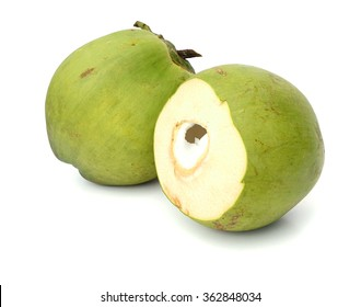 Fresh green young coconut split in half showing white flesh, isolated on white background