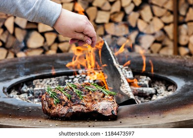Fresh grilled meat with rosemary twigs ready for eating