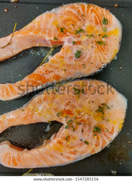 Fresh grilled salmon with aromatic herbs.