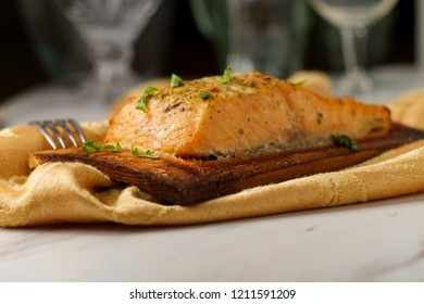 Fresh grilled salmon seasoned with citrus and herb rub served on cedar plank