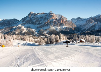 Fresh groomed ski piste with amazing winter landscape in the Alps, Dolomites, Morning view. Alta Badia, Sella Ronda. Italy. Famous ski resort.