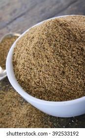 fresh ground cardamom spice in dish