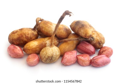 Fresh groundnuts on white background