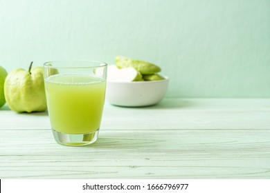 fresh guava juice glass with fresh guava fruit on wood table