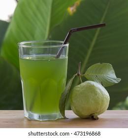 Fresh guava juice on the garden background