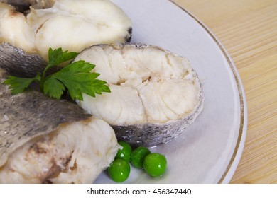 fresh hake on wooden background