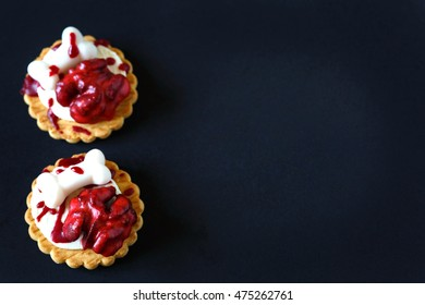 Fresh halloween bloody brain biscuits on dark background with place for text.