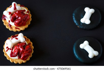 Fresh halloween bloody brain and sugar bones biscuits on dark background with place for text.