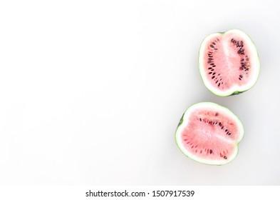 Fresh halves of watermelon on a light beige background.