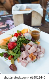 fresh ham salad served on a white plate, western style food