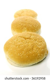 Fresh hamburger buns isolated against a white background