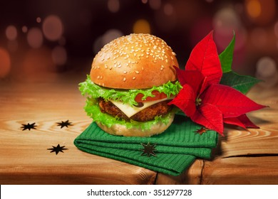 Fresh hamburger and christmas decor with poinsettia flower.