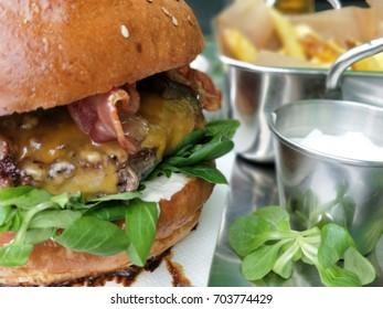 Fresh hamburger with salad and chips.
