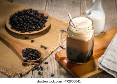 Fresh hand made nitrogen infused nitro coffee in jar artistic decoration decor delicious straw