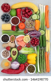 Fresh health food collection wiith salmon, legumes, fruit, vegetables, dairy, spice, green tea with superfoods high in antioxidants, vitamins,dietary fibre, and anthocyanins. Top view.