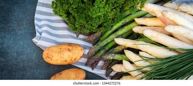 Fresh healthy asparagus with potatos and herbs