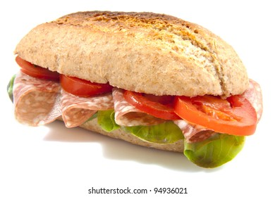 Fresh healthy bun with salad and salami isolated over white