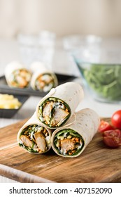 Fresh healthy chargrilled tandoori chicken wrap with tzatziki, cheese, baby spinach and carrots