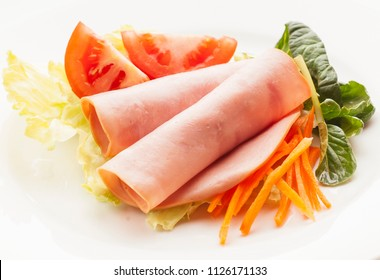 Fresh and healthy cold salad of raw vegetables and turkey ham