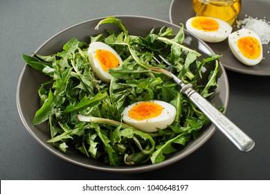 Fresh healthy dandelion salad with eggs overhead shoot