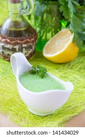 Fresh healthy green sauce made from yogurt and coriander for summer salad