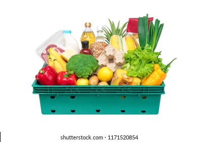 Fresh healthy groceries and vegetables from supermarket in green tray box isolated on white background