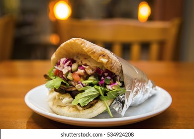 Fresh Healthy Mediterranean Pita Wrap with Eggplant, Onions, Cucumbers, Purple Cabbage and Vegetables