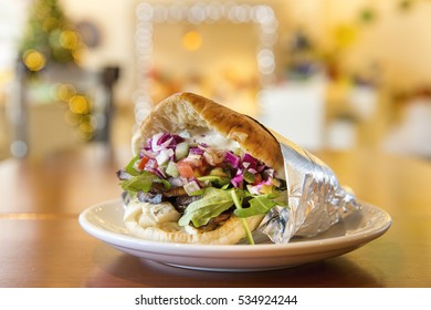 Fresh Healthy Mediterranean Pita Wrap with Eggplant, Onions, Cucumbers, Pruple Cabbage and Vegetables