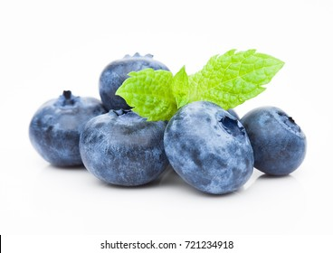 Fresh healthy organic blueberry with mint leaf on white background